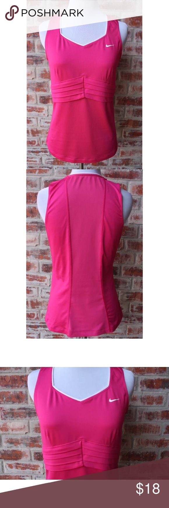 """Nike Dri-Fit Hot Pink Workout Top Sports Shirt M This pink ladies Nike Dri Fit tank top is a size medium and in excellent condition!  It does not have a built in bra.  Measures 16"""" across chest from armpit to armpit without stretching the top and length is 22.5"""". Nike Tops Tank Tops"""