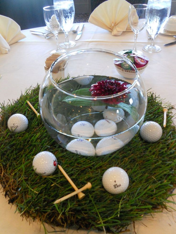 golf centerpieces - cute idea for the putt-putt table - maybe with floating rose candles? and some peach ribbon?