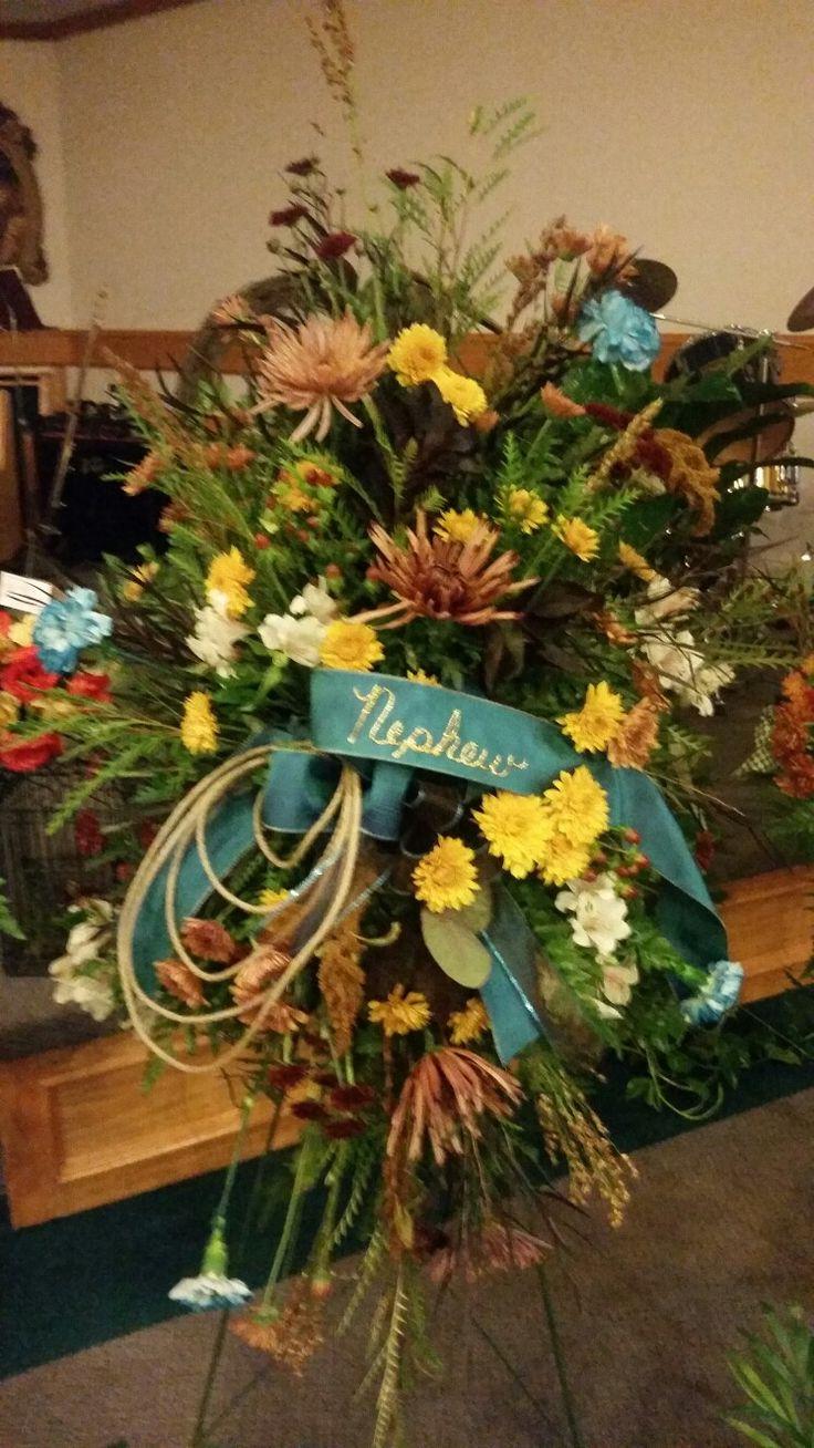 Fresh funeral spray, western theme Funeral flower