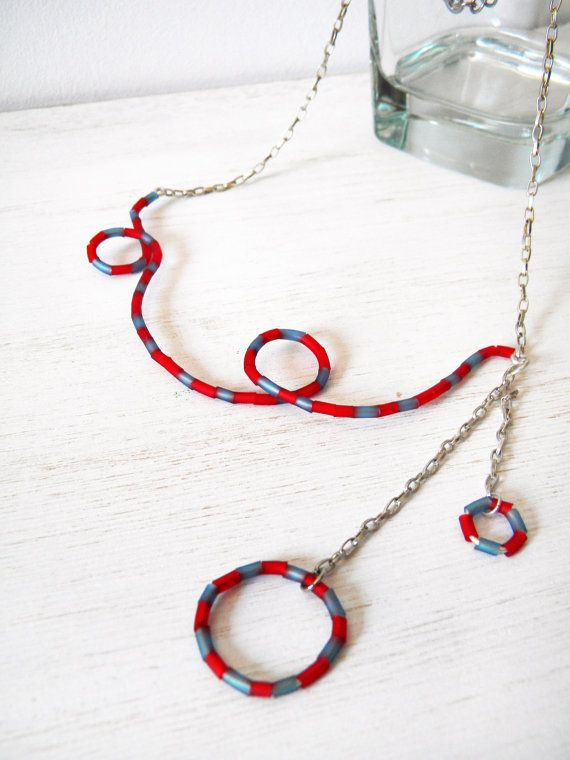 Red and blue necklace rubber on silver plated wire by BlackRedDots, $25.00