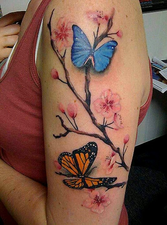 A dogwood branch with a butterfly that matches my mom's <3 on my shoulder, because mom is always behind me and my decisions no matter what <3