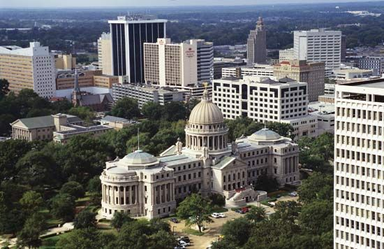 The State Capitol of Jackson, Mississippi, is nestled between high-rise buildings.