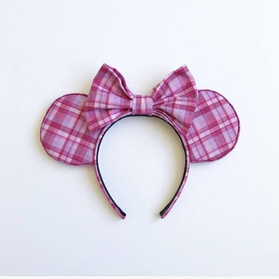 Pink Plaid Flannel Mouse Ears With Bow PRODUCT DETAILS -Pink plaid flannel fabric for ears -Pink plaid flannel bow -1 inch headband INCLUDES -1 pair of Pink Plaid Flannel Mouse Ears **All of our ears are handmade with lots of love. No two items are identical **Please message us any
