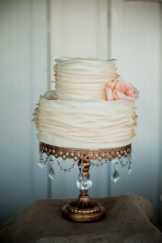 Gorgeous wedding cake.  Simple. Elegant. I like everything about this one-ruffles, color, shape.  My favorite!