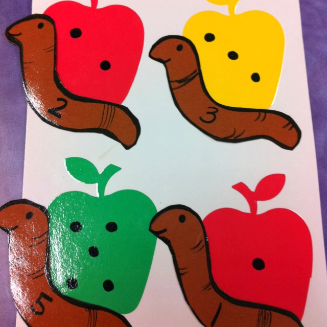 Match numbers to dots. Die cut apples w dots written on them. Make your own worms with the numbers & voila.....instant math center! Great!