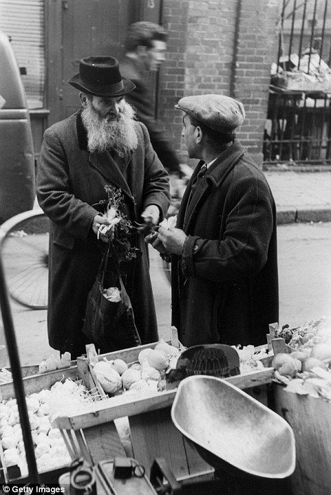 Buying vegetables  at a stall in 1952 Whitechapel at a time when the Jewish population thrived in the area