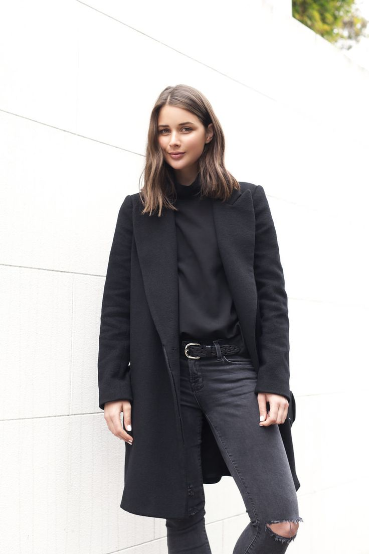 Black ripped jeans and structured coat