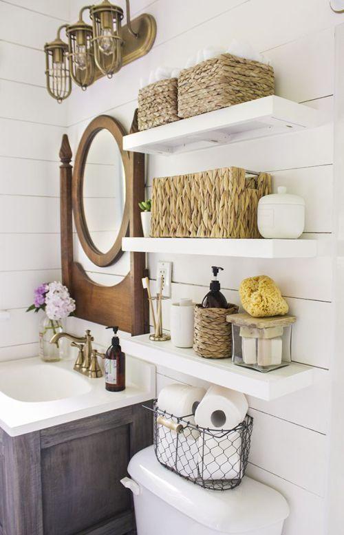 Coastal bathroom with open shelves for storing bathroom goods