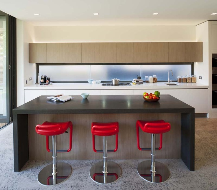 Sleek - and practical - kitchen feat. a window splashback.  {A beachside…
