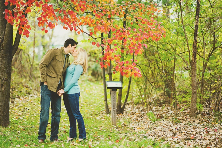 Another one of our favorite vintage engagement photo taken in liberty state park in new jersey. The city and even the park is very urban and we wanted to find a photo spot that give us a feel of those southern and country engagement photography.   The time was near the end of fall and we were trying to find some pretty leaves. We just happened to spot this red tree, which made a perfect engagement picture location!