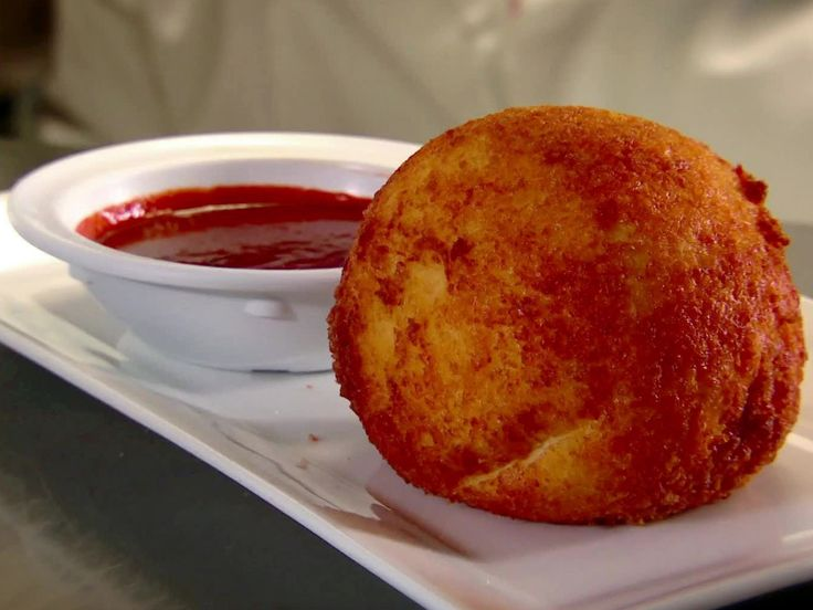 Papa Rellena con Salsa Ranchera (Stuffed Potato with Spicy Creole Sauce) recipe from Diners, Drive-Ins and Dives via Food Network