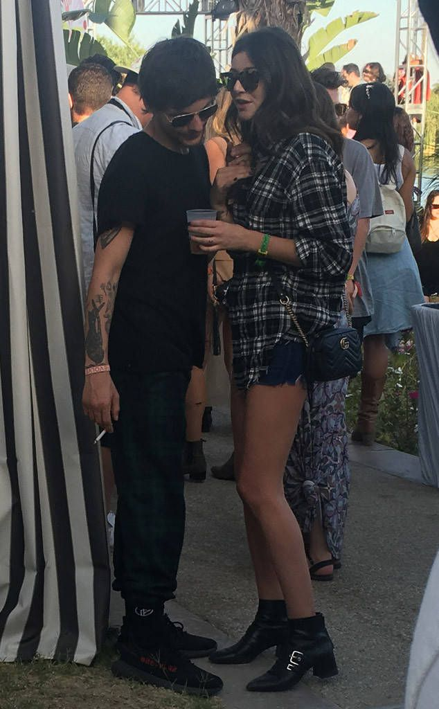 Louis Tomlinson and Eleanor Calder from Coachella 2017: Star Sightings The former One Direction singer and his girlfriend were spotting chatting at the Revolve Festival party on Sunday, April 16.