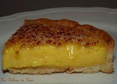 TARTE A L'ORANGE (Pâte sucrée : 250 g de farine T55, 140 g de beurre, 100 g de sucre, 1 jaune d'œuf, 2 à 3 cl d'eau selon pouvoir d'absorption de la farine) (CREME : 230 g de jus d'orange frais, zeste finement râpé de 2 oranges, 75 g de sucre, 3 œufs + 2 jaunes, 25 g de maïzena, 185 g de beurre très froid) (CARAMELISATION : 50 g de cassonade)