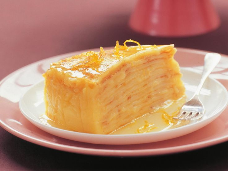 This lemon curd crepe cake is a deliciously sophisticated version of pancakes with lemon and sugar. Be sure to cook the curd gently over simmering water, and don't let the bowl touch the base of the pan.