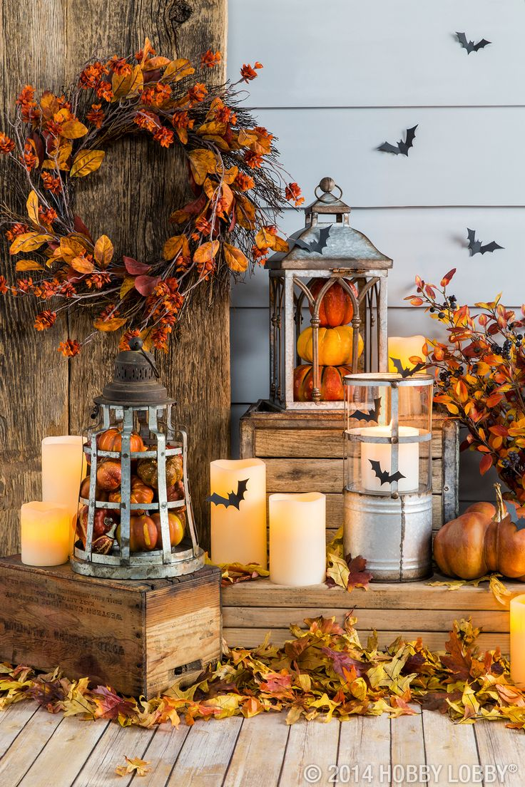 fill lanterns with pumpkins and other fall pieces for an easy diy decor idea halloween porch decorationsfall