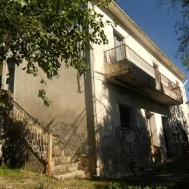 Country house needs total restoration. 5000sq m land with woodland, olive grove, vinyard and fruit trees. 80k euros