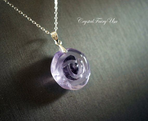 "Genuine amethyst Flower Necklace with italy 925 sterling silver Chain.    **Simply elegant beauty, perfect gift for you and your loved one for any occasion.  **Genuine store for energy, healing, rock collection, spiritual ascension as well as beautification.  ***************************  **The pendant: made of Natural amethyst engraved with Rose Flower around 22mm in diameter.  ** The Chain : Solid Italy 925 sterling silver, the model wearing the 18"", you have different options…"