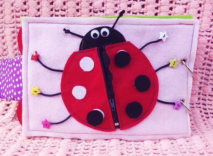 Activity 1 - Ladybird, where is your spot?  * Fine motor skills ( velcro positioning, buttons, zipping ) * Counting the legs, eyes & antenna ) #busybook