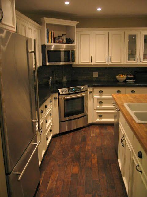 Walnut hardwood flooring in white kitchen with black for Corner cooktop designs kitchen
