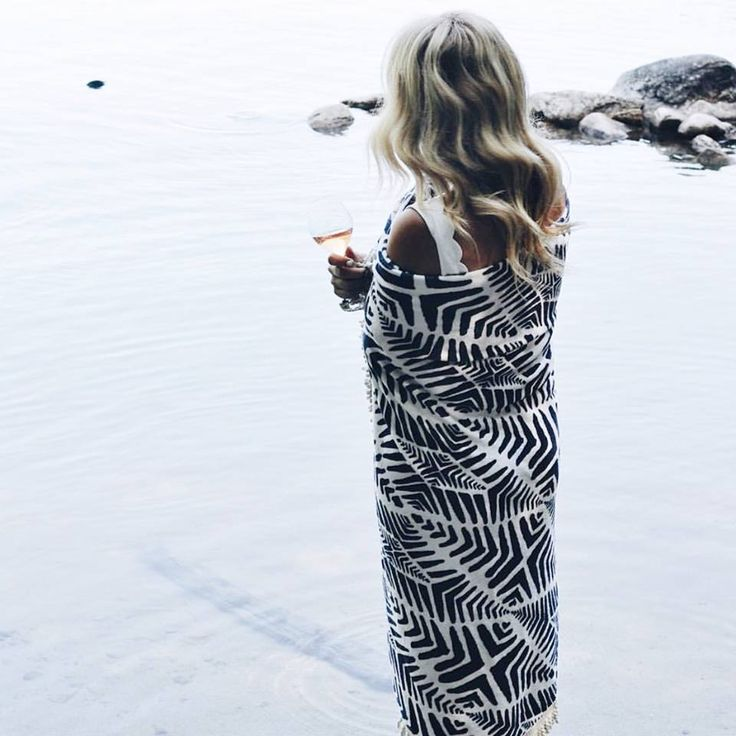 Wrapped up in a Roundie by the sea with a wine in hand...what more could you ask for // via @laurenswells