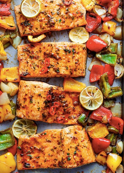 This chili lime salmon dish is the perfect addition to any party. The lime juice, red pepper flakes, garlic, and cumin give this one-sheet meal tons of fresh flavor. Bake this along with all different colored peppers and onions in order to make the salmon even more flavorful. Alter the marinade to your liking if you want a little more spiciness or sweetness—either way, you'll love this chili lime dish.