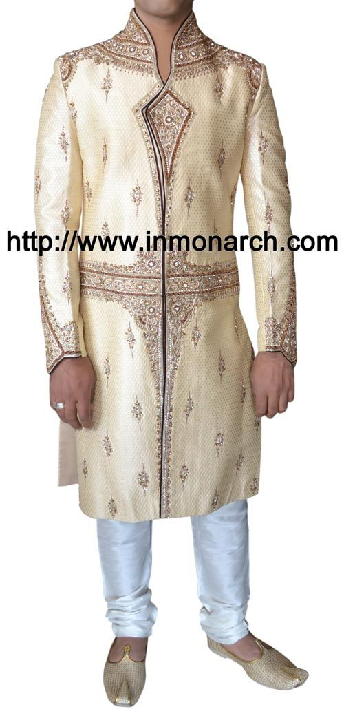 Beautiful look designer work bollywood sherwani made from ivory color brocade fabric. Hand embroidered as shown. It has bottom as chudidar made from dupion fabric in matching color.