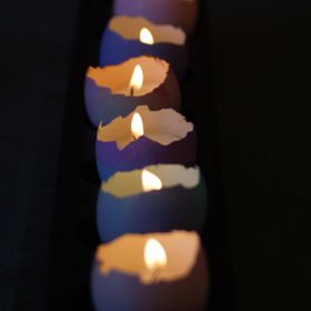 Easter Egg Votives - such a striking centerpiece and so simple to make! http://stories.savvymom.ca/Qs79