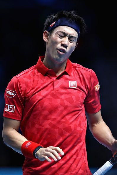 Kei Nishikori of Japan looks exasperated after losing a point during his men's singles semi final against Novak Djokovic of Serbia on day seven of...