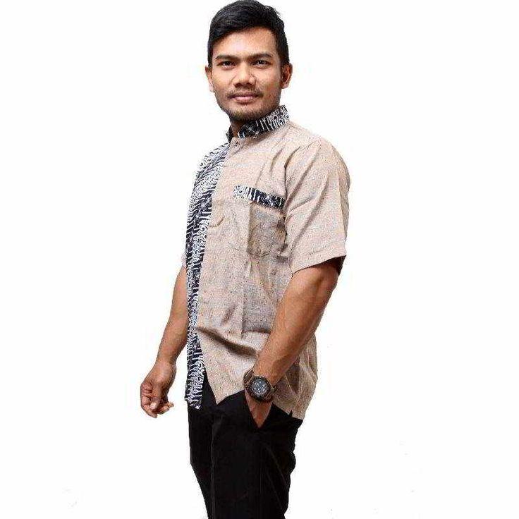 Kemeja batik koko grey dengan kombinasi batik yang menarik dan nyaman dipakai. Kemeja batik koko ini sesuai kegiatan anda