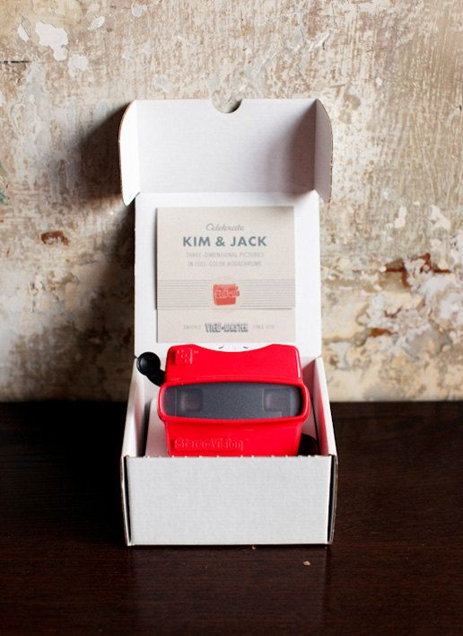 Brilliant!!! These are wedding invitations that have engagement photos of the couple in the view master!!