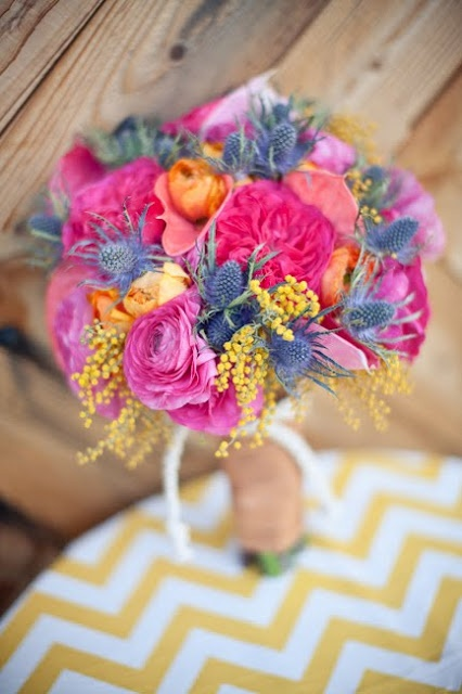 the bridal bouquet was a mix of hot pink garden roses, orange and fuschia ranunculas, blue thistle, yellow acacia and salmon colored anthirium. JL DESIGNS: a summer wedding photo shoot - the ace hotel, palm springs