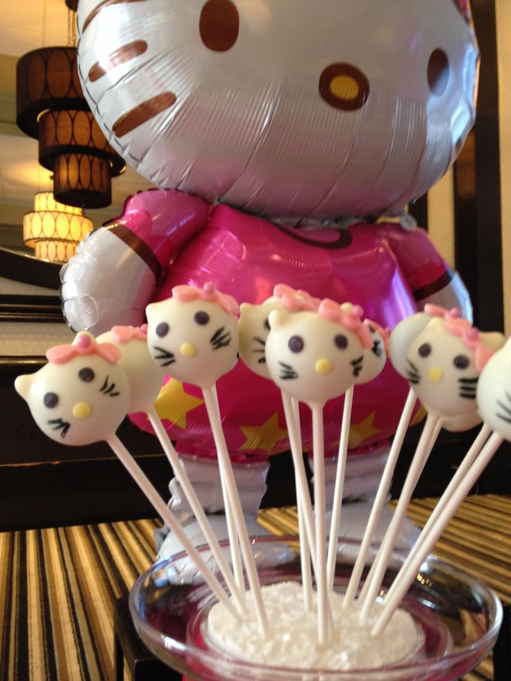 Hello Kitty Cake Pops - chocolate cake dipped in white chocolate melts and fondant bows,eyes and nose