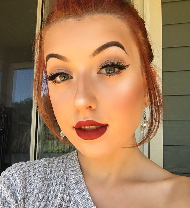 """Olivia  Manson (@elysian.artistry) on Instagram: """" Blog post coming soon about how I do my winged liner """" Red lips ginger hair retro pinup makeup"""