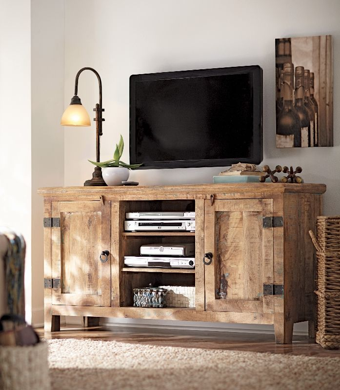 Create a decorative display around your TV with lighting, accessories and one stylish (yet functional) media cabinet. HomeDecorators.com