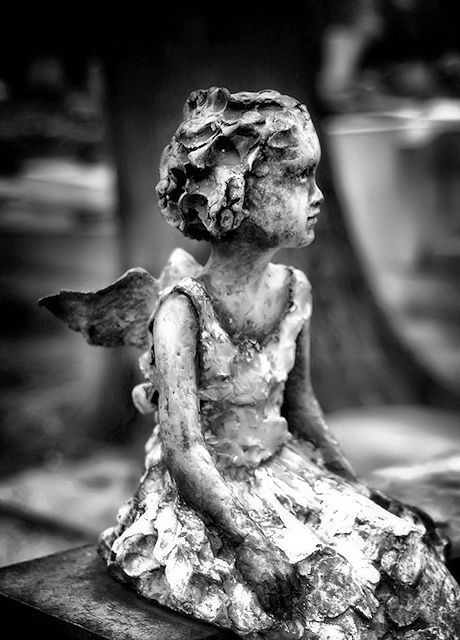 Photo of angel statue in a cemetery in France.