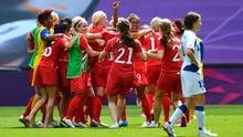 France's Elise Bussaglia walks off the pitch as Canada celebrates winning the women's bronze medal soccer match in Coventry at City of Coventry Stadium at the London 2012 Olympic Games August 9, 2012. (Reuters)