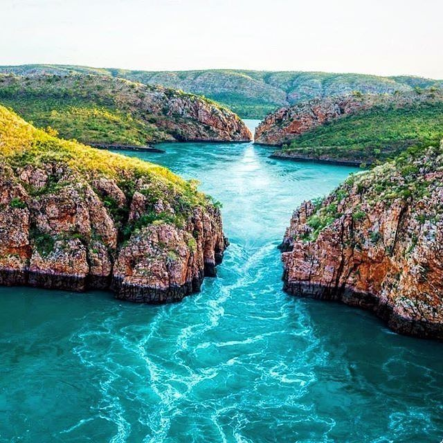Towering sea cliffs, a raging torrent of water and not another person in sight - welcome to the #HorizontalFalls in @thekimberleyaustralia!This unique 'waterfall' in the far north west of @westernaustralia is not a sight you'll see every day - it's also not technically a waterfall, but it's been dubbed the 'Horizontal Falls' due to the powerful tide which rushes between the cliffs, causing an extraordinary waterfall-like effect. Photo: @scottslawinski