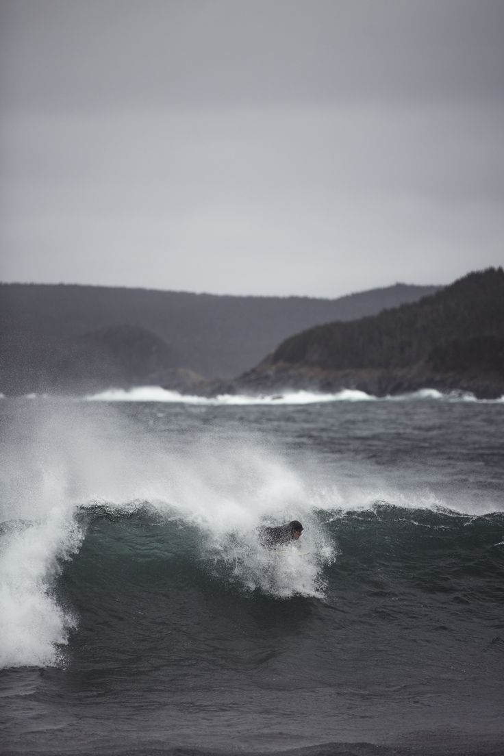 Lonesome surfer going against the harsh winds and cold water as he surfs in the North of Canada.