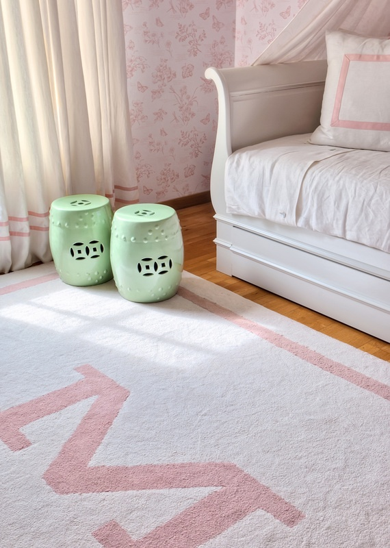 love the monogram rug and footstools!