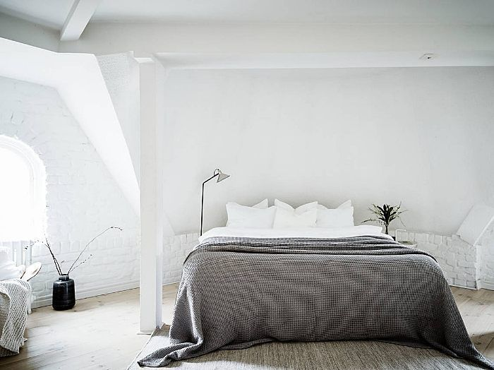 Beautiful sunny room with a simply styled bed via @greydeco.