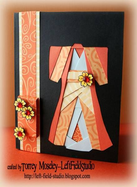 handmade card ... Asian theme ... Kimono Iris-folding card by TorreyjustTorrey ... kimono in shades of orange on black ... note: this is iris fold design but thick pieces of patterned cardstock are cut and paper pieced in like the thinner folded papers would be ... like how the shades of color define the different areas ... luv this card!!