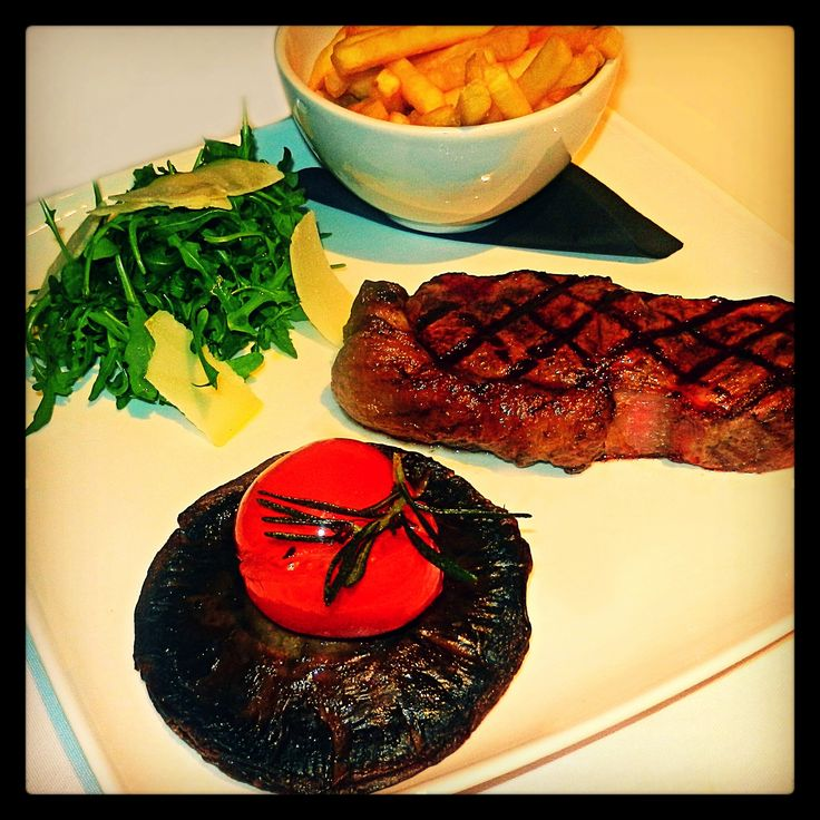 Primal Steak: 12oz. sirloin steak, 21 days matured and chargrilled to roartastic perfection, with grilled field mushroom & tomato, salad and a green peppercorn sauce. Served with fries or herb & garlic mashed potato. Add three tiger tail prawns for just £2.50!