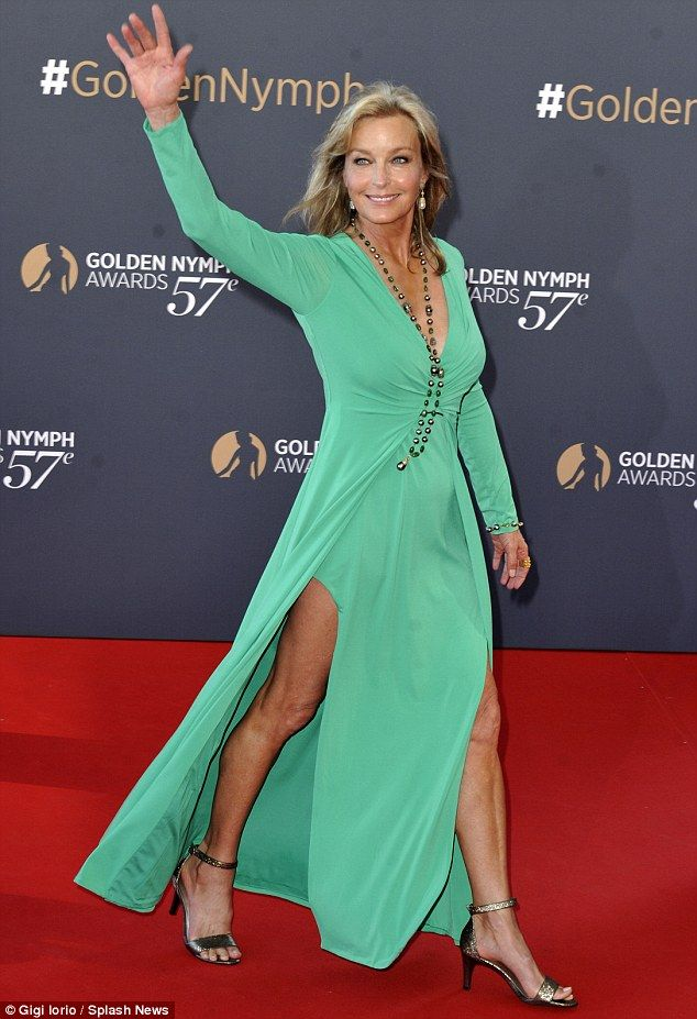 Gorgeous: Bo Derek proved she was as radiant and youthful as ever as she made a dazzling entrance. Green goddess, side slits, sandals, June 2017