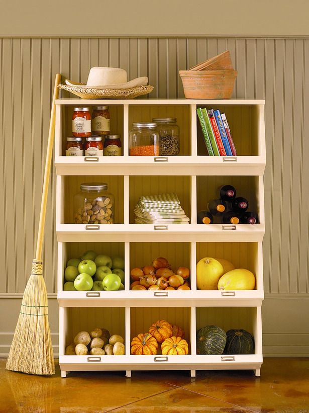 Store veggies, fruits, cookbooks and other bulky items in this hardwood lacquered bin that's modeled after early American cabinets with its 12 spacious open compartments and bin label holders.