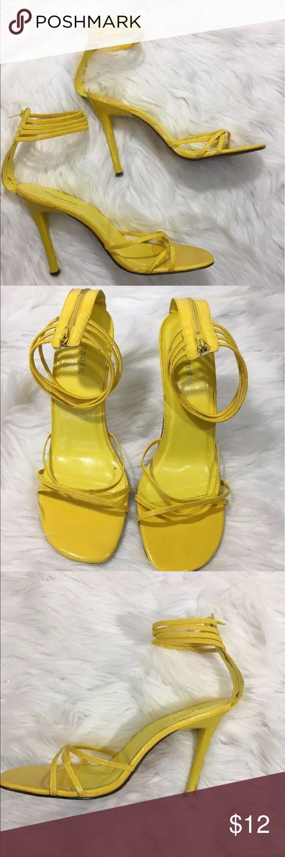 Strappy Heels Pre-owned. Yellow. Straps around ankles and toes. Zipper in back. 4.5 inch heel. Scuffed on left heel. Peeling on back of right heel under zipper (not visible when wearing). See pics Hypnotic Shoes Sandals