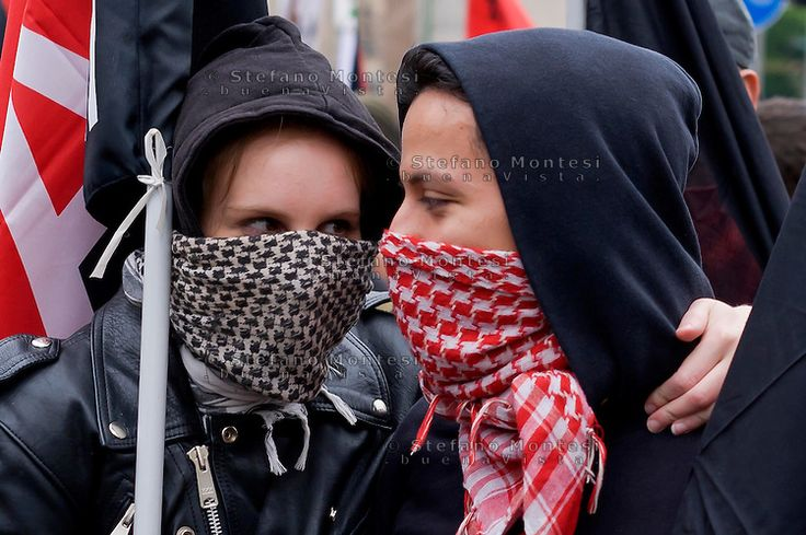 Milan, May 1, 2015 Mayday NoExpo Clashes protesters against police during the demonstration in downtown Milan, to protest against Universal Exposition Milano 2015. Tenderness between girls before the demostration.