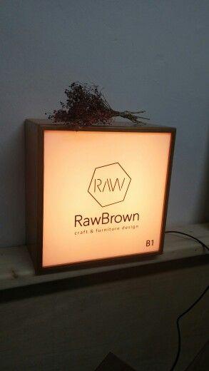 rawbrown wooden signboard