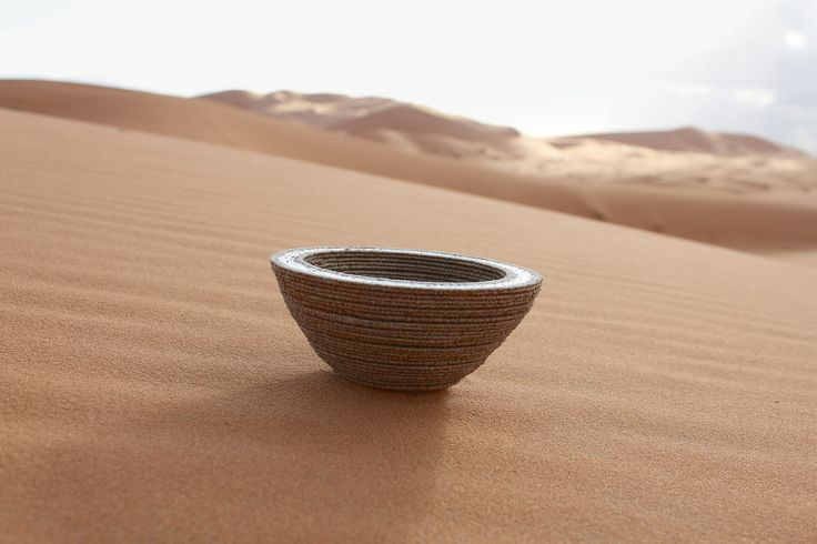 Glass bowl made using the Solar Sinter machine which is a 3D printer that uses solar power to turn sand into glass. Designer Markus Kayser (http://www.markuskayser.com/) took the printer to the Sahara desert to create this piece.