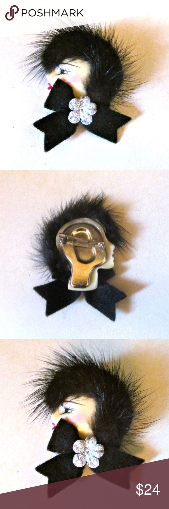 "Vintage Woman Real Fur Hair Brooch Pin Vintage Woman Real Mink Fur Hair Brooch Pin Very cool vintage brooch made of an early plastic with real fur for hair, a black felt ribbon and silver flower applique. Measures approx. 2.5"" in length Condition: Very good vintage. A tiny spot of glue residue on back of brooch. Smoke-free closet. Vintage Jewelry Brooches"