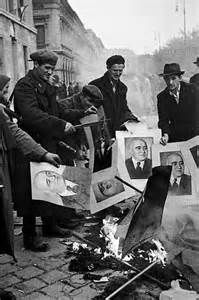 Burning of photos of Communist leader during Hungarian Uprising Oct. 1956